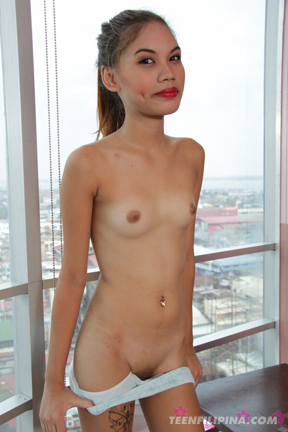 skinny-and-hot-filipina-cutie-chris-posing-in-the-window